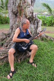 Pili playing Emerald X20 guitar under the trees at Kapahukapu (Manini Beach Park)